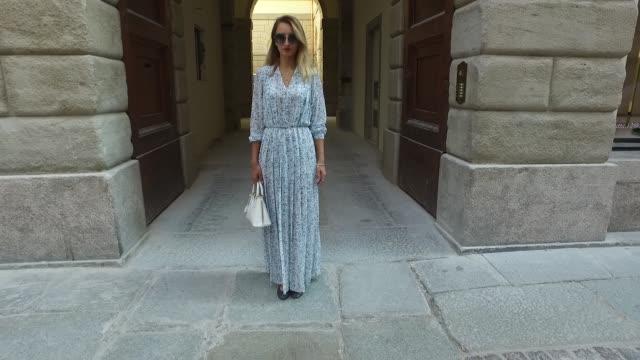 Maria Senchenko wearing a Mauro Grifoni dress Lanvin shoes Prada bag and Miu Miu sunglasses on September 25 2016 in Milan Italy