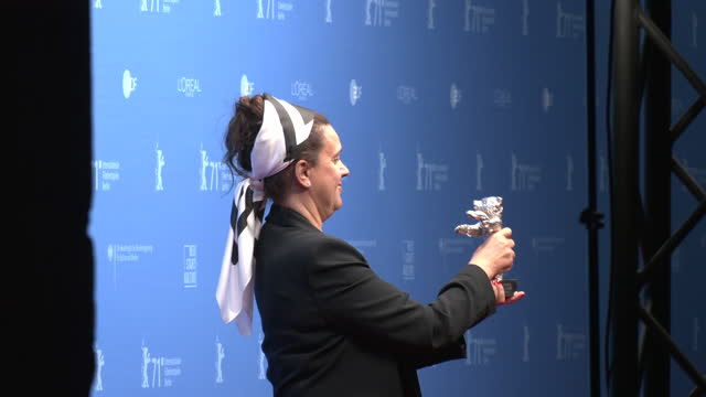 """maria speth, winner of the silver bear jury prize for their movie """"herr bachmann und seine klasse"""" poses with their trophy during a photocall after... - celeb stock videos & royalty-free footage"""