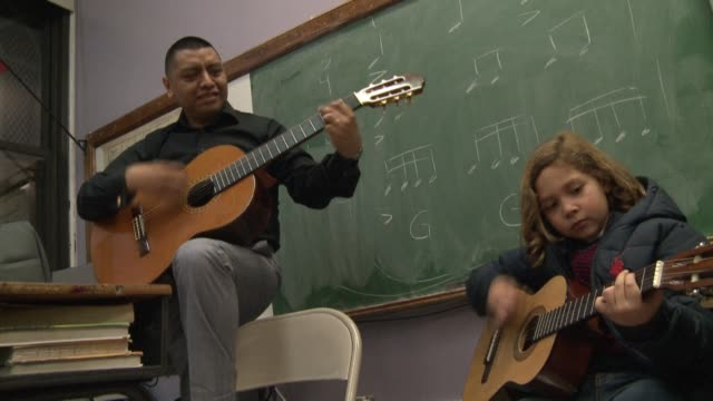 mariachi isn't just about big hats and bold style it's serious musicmaking as one school dedicated to the art form is out to prove new york united... - music style stock videos and b-roll footage