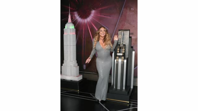"""mariah carey lights the empire state building in celebration of the 25th anniversary of """"all i want for christmas is you"""" at the empire state... - mariah carey stock videos & royalty-free footage"""