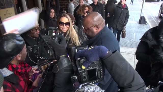 mariah carey poses with a fan outside the z100 radio station celebrity sightings in new york on february 12 2014 in new york city - mariah carey stock videos and b-roll footage