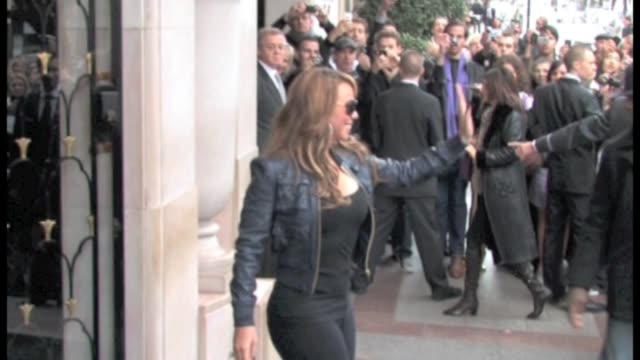 mariah carey shares some love with french fans in paris france the american singer leaves the georges v palace to nrj radio station we spotted the... - mariah carey stock-videos und b-roll-filmmaterial