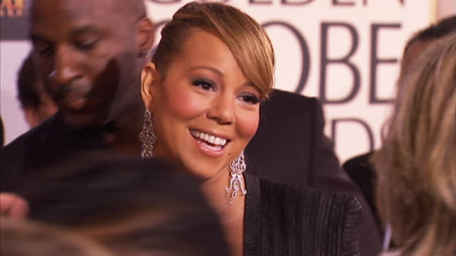 MCU Mariah Carey speaks to woman briefly in crowd before making her way down red carpet waving and smiling at paparazzi