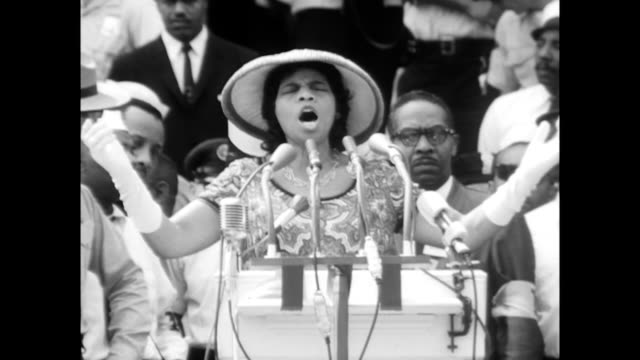 vídeos de stock e filmes b-roll de / marian anderson introduced and sings 'he's got the whole world in his hands' / a philip randolph shaking her hand before she sings / crowd... - 1963