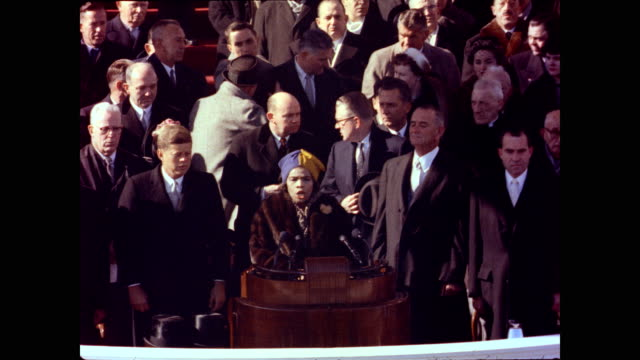 vídeos de stock, filmes e b-roll de / marian johnson sings the national anthem as john f kennedy lyndon johnson richard nixon and others stand by marian anderson sings national anthem... - tomada de posse