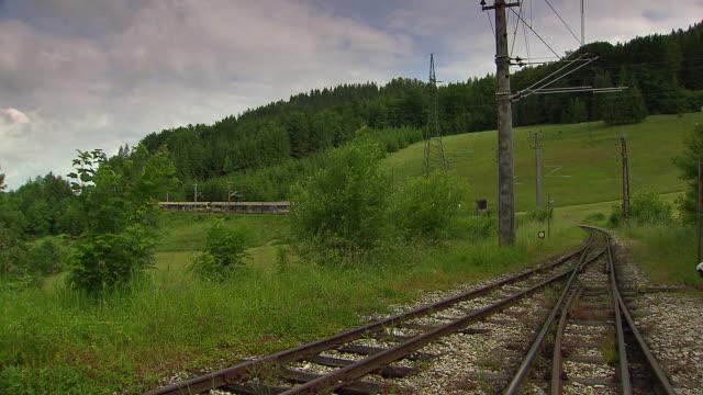mariazellerbahn - alpine train approaching from the distance in lower austria - オーストリア点の映像素材/bロール