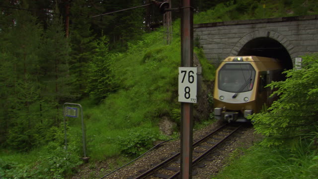 Mariazellerbahn - Alpine train comes out of a tunnel in lower austria 02