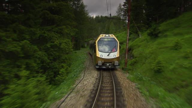 mariazellerbahn - alpine train goes in and out of tunnels in lower austria - オーストリア点の映像素材/bロール