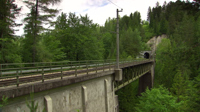 Mariazellerbahn - Alpine train goes through a tunnel and over a bridge in Lower Austria