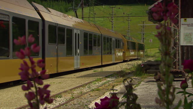mariazellerbahn - alpine train stopped at a station in lower austria - lower austria stock-videos und b-roll-filmmaterial
