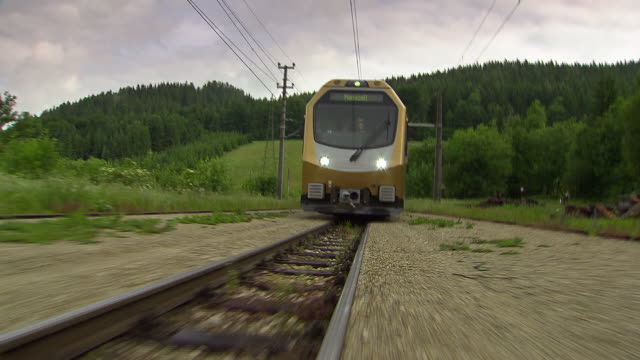 mariazellerbahn - low angle view of alpine train the the tracks in lower austria - オーストリア点の映像素材/bロール