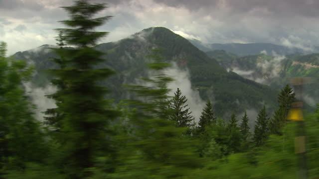 mariazellerbahn - train on the tracks with alpine views in lower austria 02 - lokomotive stock-videos und b-roll-filmmaterial