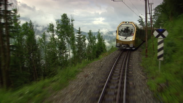 mariazellerbahn - train on the tracks with alpine views in lower austria 03 - austria video stock e b–roll