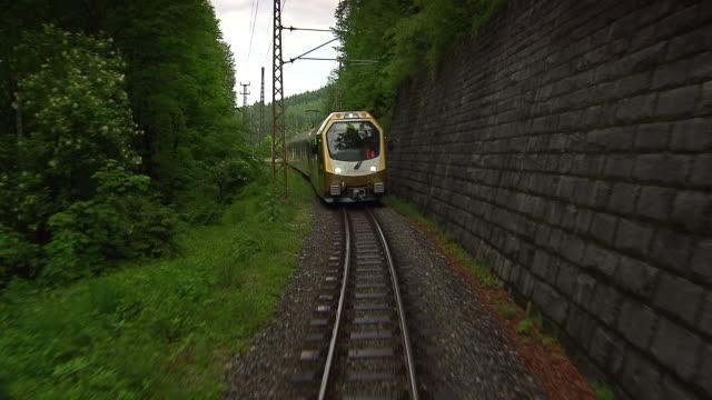 mariazellerbahn - train on the tracks with alpine views in lower austria - オーストリア点の映像素材/bロール