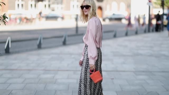 marie hindkaer wearing pink blouse skirt with snake print orange mini bag is seen outside designers remix during the copenhagen fashion week... - blouse stock videos & royalty-free footage