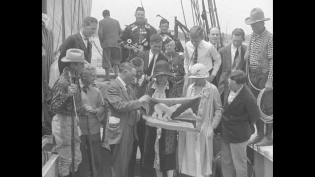 marie stafford daughter of adm robert peary presenting flag showing polar bear to capt bob bartlett with others aboard schooner effie m morrissey... - effie stock videos and b-roll footage