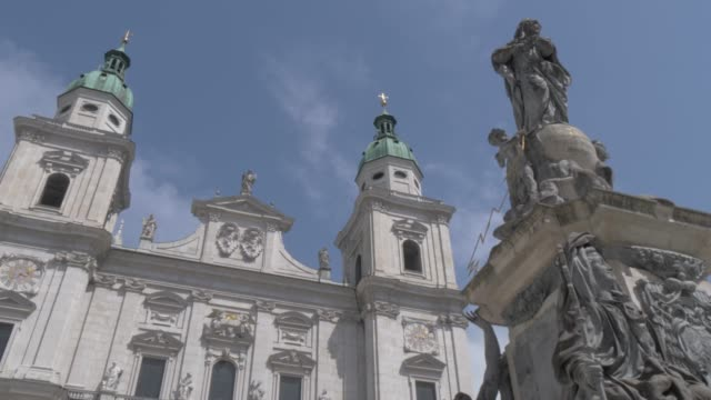 marien statue and cathedral in domplatz, unesco world heritage site, salzburg, austria, europe - female likeness stock videos & royalty-free footage
