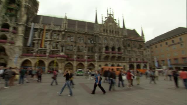WS PAN Marienplatz with pedestrians walking in front of New Town Hall / Munich, Bavaria, Germany