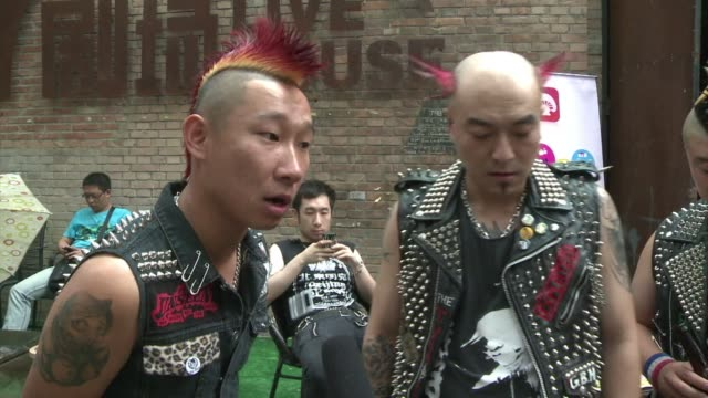 A marigold and magenta mohawk adorning his shaven skull Chinese punk rocker Shan Lin has a subversive message in a country that suppresses dissent a...