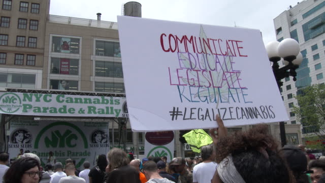 Marijuana legalization advocates hold signs up high as they listen to speakers at the annual Cannabis Day Rally in Union Square Park New York