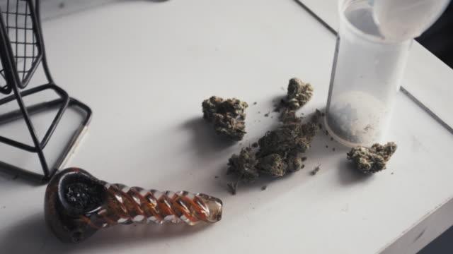 marijuana paraphernalia - marijuana herbal cannabis stock videos and b-roll footage