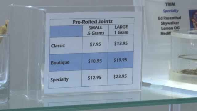 Marijuana pipes joints books and the waiting room and treatment room of a medical marijuana dispensary