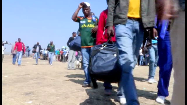 marikana mine shootings: miners charged with murder / torture claims; *uk rights only, no international use* south africa: rustenburg: marikana: ext... - only young men stock videos & royalty-free footage