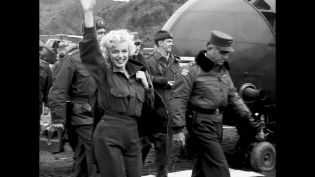 stockvideo's en b-roll-footage met marilyn exits helicopter is greeted by general lionel mcgarr / marilyn gets into a staff car - marilyn monroe