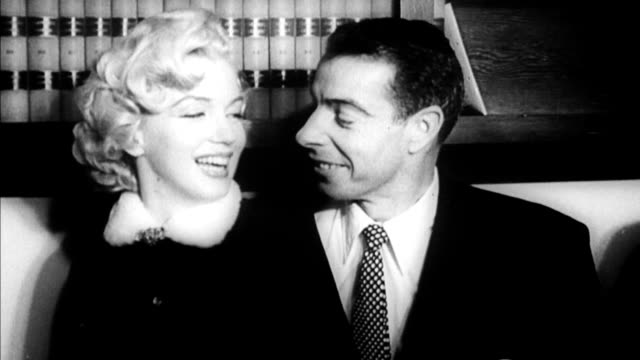 stockvideo's en b-roll-footage met marilyn monroe and joe dimaggio pose for photographers after getting married / they look adoringly at each other and kiss marilyn monroe and joe... - marilyn monroe
