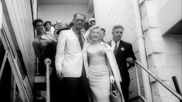 marilyn monroe and playwright arthur miller walking down steps at idlewild airport on their way to london. july 13, 1956 in queens, new york - 1956 stock videos & royalty-free footage