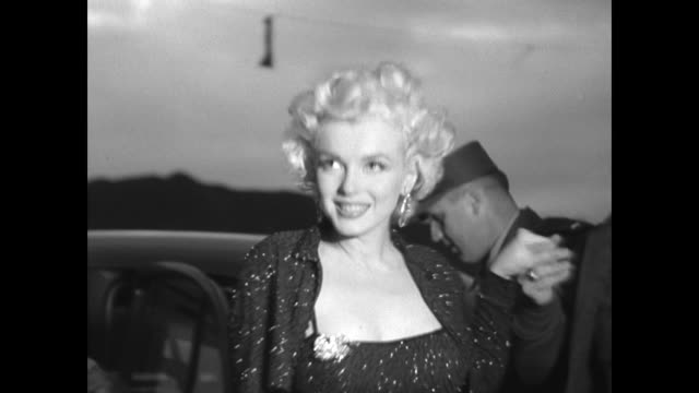 stockvideo's en b-roll-footage met marilyn monroe arriving in car for peformance before gi troops in korea - marilyn monroe