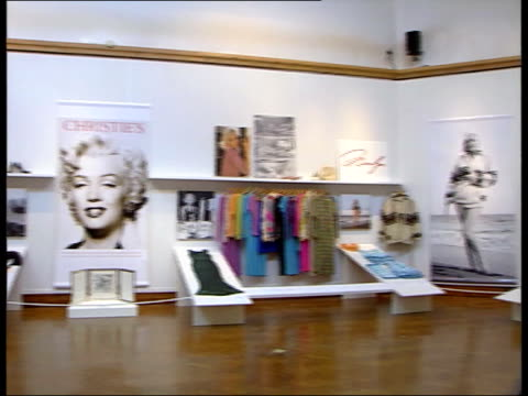 1300 u'lay itn england london christies marilyn monroe clothes and memorabilia on display pan tms full length backless evening dress on display - length stock videos & royalty-free footage
