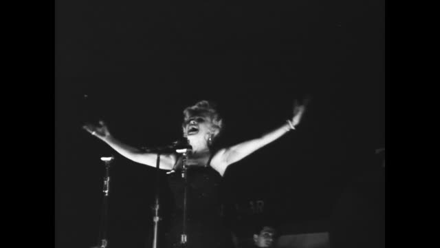 marilyn monroe performing at night for gi troops in korea - 1954 stock videos & royalty-free footage
