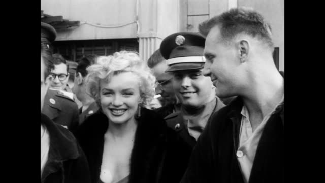 stockvideo's en b-roll-footage met marilyn monroe says goodbye at the hospital / final visit surrounded by guards / marilyn waves at the crowd of staff children and public marilyn... - marilyn monroe