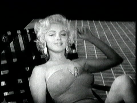 stockvideo's en b-roll-footage met marilyn monroe sitting in lawn chair drinks from glass then sexily talks to camera, saying, `i hate a careless man'. marilyn monroe talking to camera... - 1955