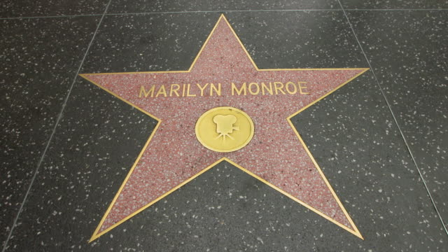 ms marilyn monroe star on hollywood walk of fame / hollywood boulevard, los angeles, california, united states  - ウォークオブフェーム点の映像素材/bロール