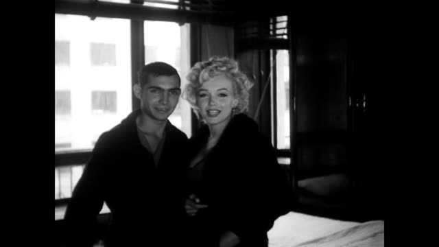 stockvideo's en b-roll-footage met marilyn monroe visits tokyo hospital speaking with injured veterans female and male / poses for a photo with patient / cars driving down the road... - marilyn monroe