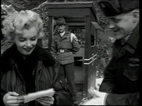 marilyn monroe walking with troops / officer giving marilyn some mail / soldiers lining up to meet marilyn / sign saying 'welcome marilyn monroe'... - mail stock videos & royalty-free footage