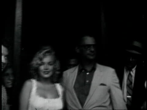 marilyn monroe with husband arthur miller as they leave the doctors hospital after a miscarriage / she semi reclines in ambulence seat and is covered... - 1957 stock videos & royalty-free footage