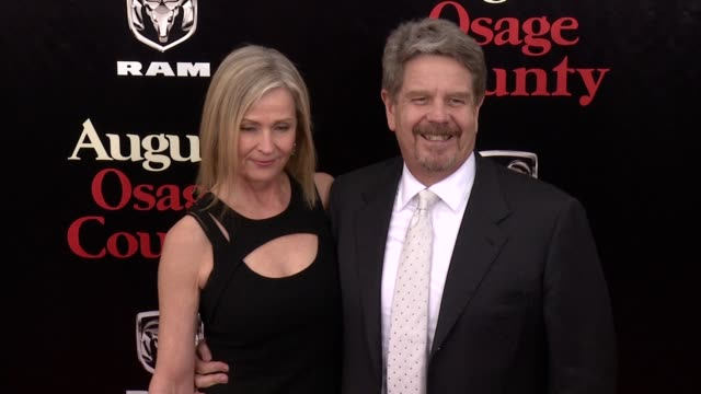 marilyn wells and john wells at 'august: osage county' new york premiere at ziegfeld theater on in new york city. - brian wells stock videos & royalty-free footage