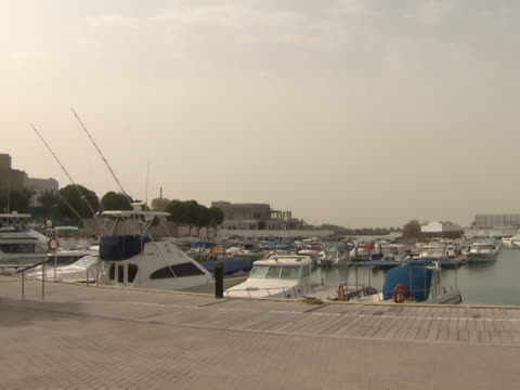 marina, abu dhabi. view of yachts and boats moored in a small marina. - luxury stock videos & royalty-free footage