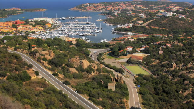 zo ws ha marina and roads at porto cervo / sardinia, italy - sardinien stock-videos und b-roll-filmmaterial