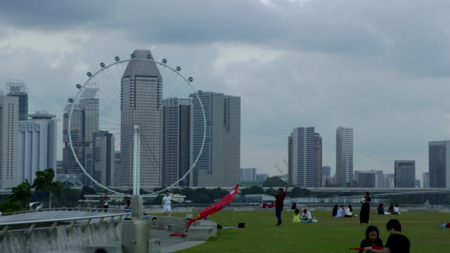 marina barrage park and singapore flyer - singapore flyer stock videos and b-roll footage