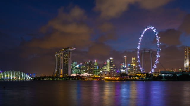 tl ws marina bay and singapore skyline at night - singapore flyer stock videos and b-roll footage