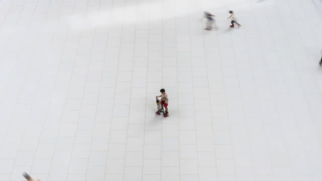 ws t/l marina bay sands, children skating on artificial skating rink in shopping centre / singapore - ice rink stock videos & royalty-free footage