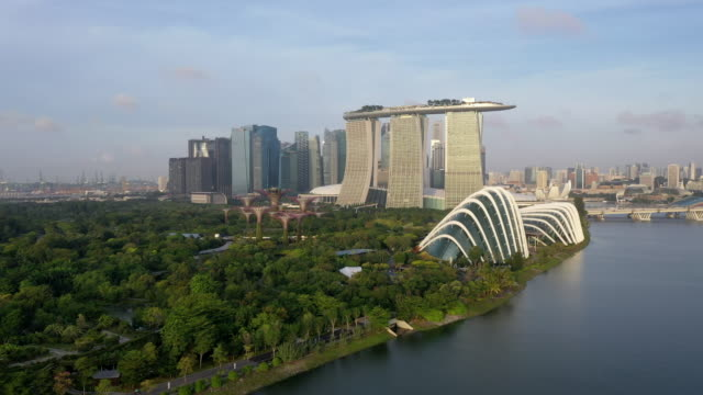 marina bay sands hotel, gardens by the bay, flower dome and cloud forest, supertree grove and downtown area / downtown core, singapore - singapore stock videos & royalty-free footage