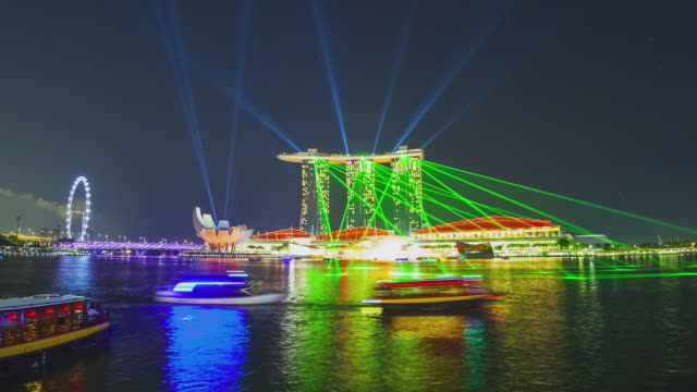 t/l marina bay sands light show with the singapore flyer - ferry ride stock videos & royalty-free footage