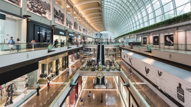 t/l of marina bay sands shoppers shopping mall - shopping mall stock videos & royalty-free footage