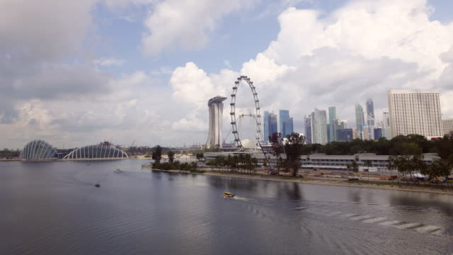 t/l ws marina bay singapore flyer and downtown/singapore - singapore flyer stock videos and b-roll footage