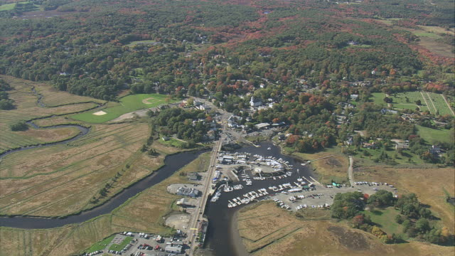 aerial marina, boat and yacht dock slips surrounded by rural greenery / essex, massachusetts, united states - nightdress stock videos & royalty-free footage